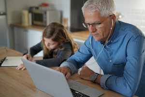 Father and school-girl working form home, telework and e-learnin